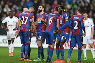 The Crystal Palace players inc Emmanuel Adebayor (2nd right) line up their defensive wall ahead of a Swansea city free-kick. Barclays Premier league match, Swansea city v Crystal Palace at the Liberty Stadium in Swansea, South Wales on Saturday 6th February 2016.<br /> pic by Andrew Orchard, Andrew Orchard sports photography.