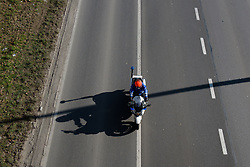 Police moto outrider checks the course is clear at Le Samyn des Dames 2018 - a 103 km road race on February 27, 2018, from Quaregnon to Dour, Belgium. (Photo by Sean Robinson/Velofocus.com)