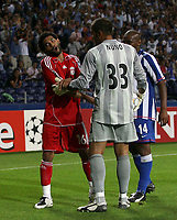 Photo: Paul Thomas.<br /> Porto v Liverpool. UEFA Champions League Group A. 18/09/2007.<br /> <br /> Jermaine Pennant (L) of Liverpool is sent off by referee Lubos Michel (Out of picture) for a second yellow, but isn't happy with Fucile or Porto (Out of picture) for diving.
