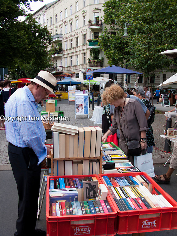 Book stall at outdoor market at Kollwitzplatz in Prenzlauer Berg district of Berlin Germany