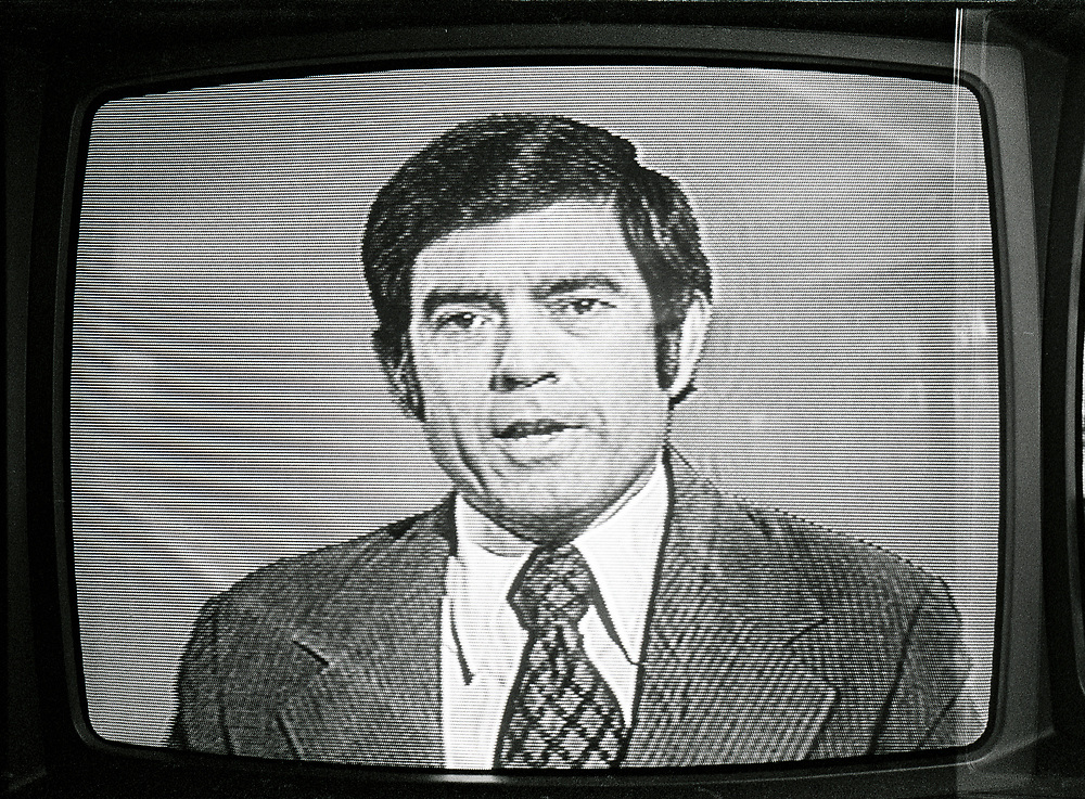 Dan Rather, seen on TV screen in late 1970s.  News broadcast.