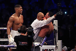 29 April 2017 - Boxing - Anthony Joshua v Wladimir Klitschko (IBF and WBA heavyweight) - Anthony Joshua smiles as the Referee steps in to end the fight - Photo: Marc Atkins / Offside.