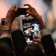 An attendee uses an electronic tablet as he watches President Barack Obama depart after his speech at the NALEO (National Association of Latino Elected and Appointed Officials) conference at the Disney Contemporary Resort Convention Center in Lake Buena Vista, Fla. on Friday, June 22, 2012. (AP Photo/Alex Menendez) President Barack Obama speaks in Orlando, Florida.