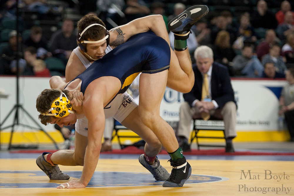 Jorge Lopez of Delbarton High School defeats by sudden victory John Boyle of Rutherford High School during the NJSIAA State Wrestling consolation 3rd place match in the 138 lb weight class  at Boardwalk Hall in Atlantic CIty on Sunday March 4, 2012. (photo / Mat Boyle)