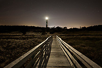 NC00885-00...NORTH CAROLINA - Boardwalk over the dunes with Cape Lookout Lighthouse on the South Core Banks, Cape Lookout National Seashore.
