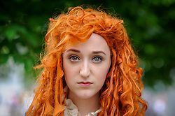 © Licensed to London News Pictures. 28/05/2017. London, UK. A girl dressed as Princess Merida as a Jedi from Brave at MCM Comic Con taking place at Excel in East London.  The three day event celebrates popular comic books, anime, games, television and movies.  Many attendees take the opportunity to dress as their favourite characters.    Photo credit : Stephen Chung/LNP