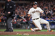 San Francisco Giants second baseman Joe Panik (12) slides into home against the Los Angeles Dodgers at AT&T Park in San Francisco, California, on April 24, 2017. (Stan Olszewski/Special to S.F. Examiner)