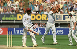 England's Phillip DeFreitas celebrates with teammate Hugh Morris after taking the wicket of Richie Richardson, caught Hick for 0, during the Fourth Cornhill Test match at Edgbaston.