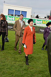 HRH The PRINCESS ROYAL and VICE ADMIRAL SIR TIMOTHY LAURENCE at the 2013 Hennessy Gold Cup at Newbury Racecourse, Berkshire on 30th November 2013.