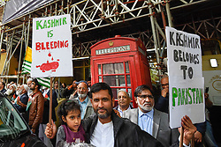 © Licensed to London News Pictures. 15/08/2019. LONDON, UK.  A father and daughter join thousands of protesters, many waving Pakistani and Kashmiri flags, outside the Indian High Commission in Aldwych, on what they are calling Black Day, to stand in solidarity with the people of Kashmir.  Indian Prime Minister Narendra Modi delivered an Independence Day speech highlighting his decision to remove the special rights of Kashmir as an autonomous region.  Photo credit: Stephen Chung/LNP