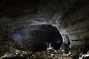 Speleologist in the Krizna Jama Cave, Cross Cave.
