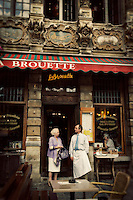 Photo of waiter and customer outside La Brouette restaurant in Grand Place, Brussels, Belgium