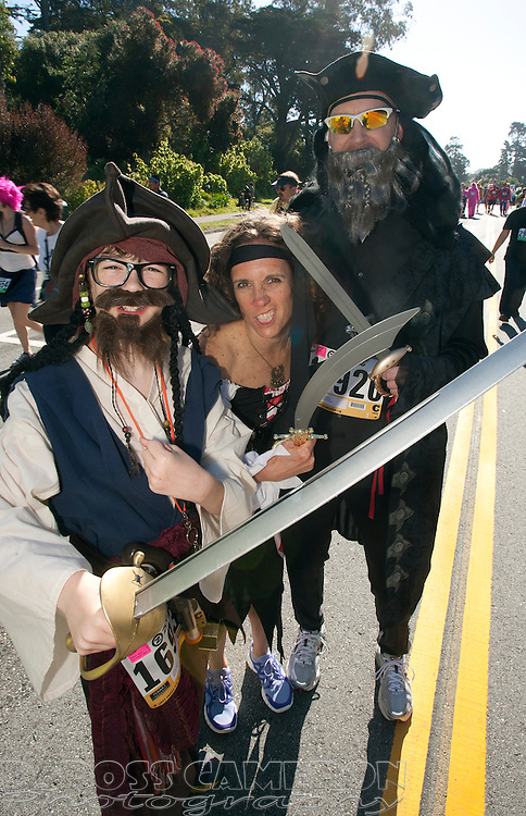 Hayden Honeycutt, 12, left, and his parents Stephanie and Mike Honeycutt of Nashville, Tenn. strike their best pirate pose during the 101st Bay to Breakers 12K footrace, Sunday, May 20, 2012 in San Francisco. More than 50,000 people participated in the 7.46-mile race, ranging from elite runners to those who ran in costume -- or nothing at all. (Photo by D. Ross Cameron)