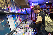 Man searching for records at RAGE, Record Art Game Emporium, on 04th April 2017 in Dublin, Republic of Ireland. RAGE is an independent record shop, selling second hand records, computer games and art in Dublin. Dublin is the largest city and capital of the Republic of Ireland.