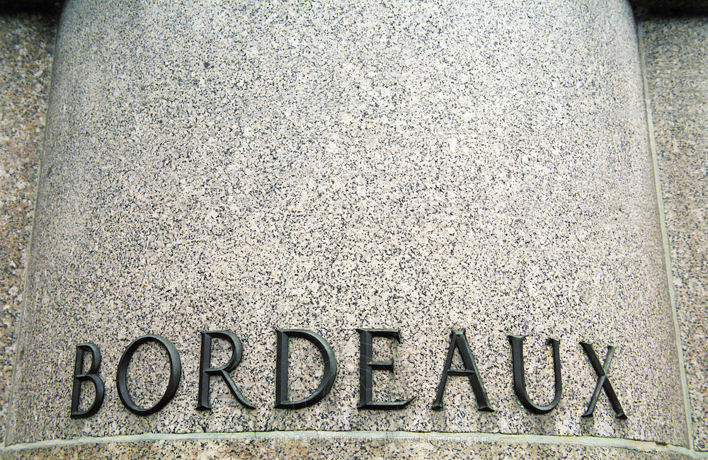 """Bordeaux"""" in big letters metal on stone on the foot pedestal of a statue. Bordeaux City, Bordeaux Gironde Aquitaine France Europe"""