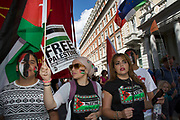 London, UK. Saturday 9th August 2014. Pro-Palestinian protesters in their tens of thousands march through central London to the American Embassy in protest against the military offensive in Gaza by Israel. British citizens and British Palestinians gathered in huge numbers carrying placards and banners calling to 'Free Palestine' and to 'End the seige on Gaza'.