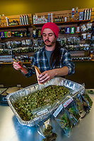"""Weighing pot at the retail """"recreational"""" counter before bagging.  Medicine Man Denver is the single largest legal medical and recreational marijuana dispensary in Denver, Colorado USA. Their 20,000 sq. ft. facility will soon double in size. Radio frequency ID tags and 65 video cameras allow the State of Colorado to track inventory through the growing process and all plant weight is accounted for. Medicine Man won the High Times' Cannabis Cup for best sativa (Jack Herer). 20-30 strains are available for sale daily."""