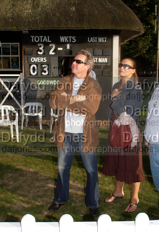 Wayne Gardner and Toni Atkinson, The Duke of Richmond and Gordon's X1 V The Earl of March and Kinrara's X1. Cricket match before the Goodwood Revival meeting, 2 September 2004. SUPPLIED FOR ONE-TIME USE ONLY-DO NOT ARCHIVE. © Copyright Photograph by Dafydd Jones 66 Stockwell Park Rd. London SW9 0DA Tel 020 7733 0108 www.dafjones.com