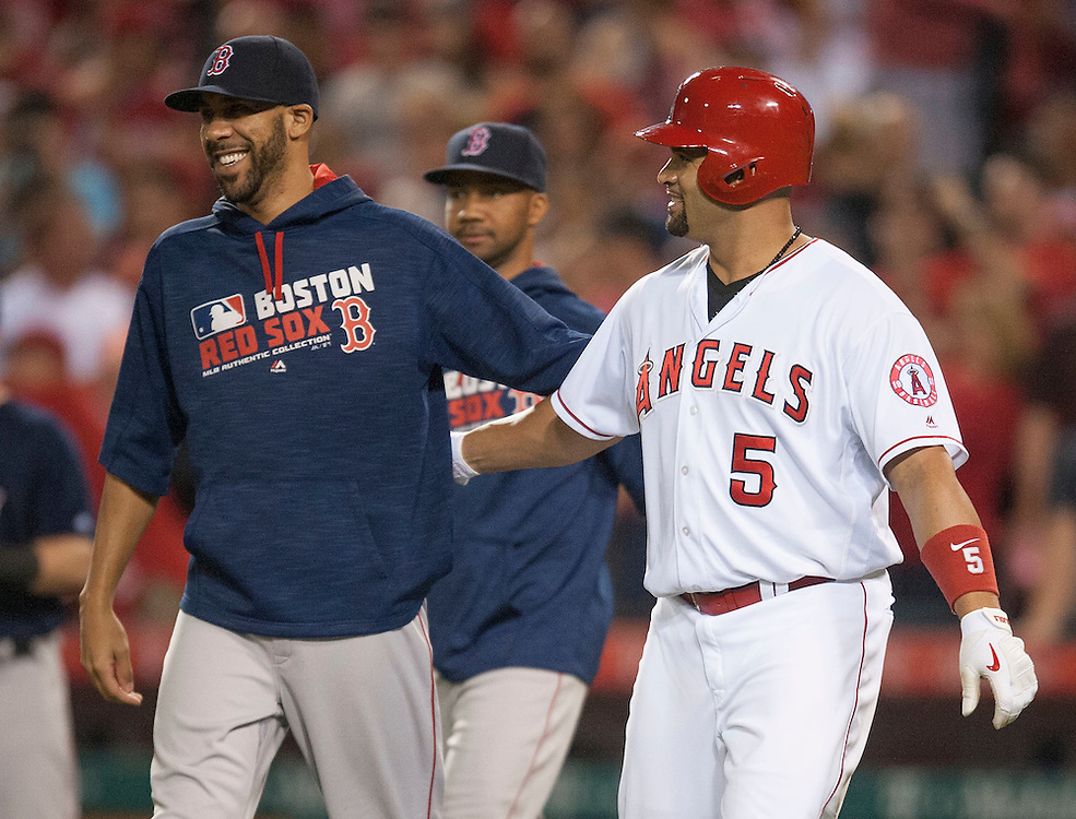 The Angels' Albert Pujols shares a laugh with Boston's David Price after the Angels' 6-2 loss to the Red Sox at Angel Stadium on Friday.<br /> <br /> ///ADDITIONAL INFO:   <br /> <br /> angels.0730.kjs  ---  Photo by KEVIN SULLIVAN / Orange County Register  -- 7/29/16<br /> <br /> The Los Angeles Angels take on the Boston Red Sox at Angel Stadium.