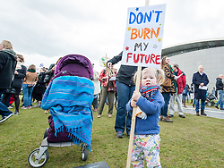 April 29, 2017 - Amsterdam, Netherlands - A young girl with pigtails holds a sign. Thousands of people take part in the 'People's Climate March' to call for an ambitious climate policy. The march took place on the 100th day of the Trump administration and was held for Climate, Jobs and Justice. (Credit Image: © Romy Arroyo Fernandez/NurPhoto via ZUMA Press)