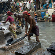 A small tank collecting water from the gutters running along the railway tracks provides a livelihood to a small community of dhobiwalas (laundrymen), who wash the clothes, sheets and blankets of the local community.