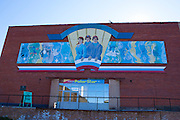 """Mural above the PolarStar shop and museum at Barentsburg, a Russian coal mining town in the Norwegian Archipelego of Svalbard. Once home to about 2000 miners and their families, less than 500 people now live here. This mage can be licensed via Millennium Images. Contact me for more details, or email mail@milim.com For prints, contact me, or click """"add to cart"""" to some standard print options."""