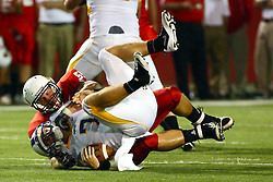 10 September 2011: Eric Brunner moves in to sack Zach Lewis during an NCAA football game between the Morehead State Eagles and the Illinois State Redbirds at Hancock Stadium in Normal Illinois.