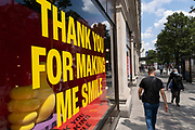 Thank you for making me smile sign in the window of Selfridges as some non-essential shops re-open, shoppers return to Oxford Street while social distancing measures are put in place by the various retail shops which are open on 26th June 2020 in London, England, United Kingdom. As the July deadline approaces and government will relax its lockdown rules further, the West End remains quiet, apart from this popular shopping district, which itself has far fewer people on its pavements than normal.