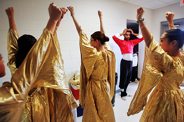 """galmh """"Nutcracker""""--Columbia City Ballet dancer Maurice Johnson helps dancers Michelle Genaro, Kelly Zeidner, Lindsey Alsip and Alex Barnaba prepare for rehearsal in Clover. Johnson goes out to communities to help the local dancers prepare for their big chance."""