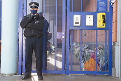 ©Licensed to London News Pictures 26/09/2020  <br /> Croydon, UK. Police stand guard at a flower memorial for Sgt Matt Ratana at Croydon Custody Centre this morning. A murder investigation has been launched by police after the death of  custody police sergeant Matt Ratana at the Croydon Custody Centre in South London yesterday.Photo credit:Grant Falvey/LNP