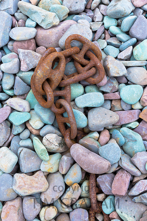 Rusty chain laid on pebbles at Porlock Weir  in Somerset, United Kingdom