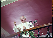 Pope John-Paul II visits Ireland..1979..29.09.1979..09.29.1979..29th September 1979..Today marked the historic arrival of Pope John-Paul II to Ireland. He is here on a three day visit to the country with a packed itinerary. He will celebrate mass today at a specially built altar in the Phoenix Park in Dublin. From Dublin he will travel to Drogheda by cavalcade. On the 30th he will host a youth rally in Galway and on the 1st Oct he will host a mass in Limerick prior to his departure from Shannon Airport to the U.S..A portrait of Pope John-Paul II waving to the crowd.