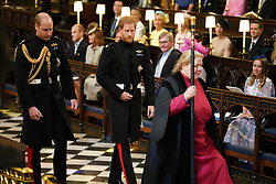 Prince Harry (centre), accompanied by his best man the Duke of Cambridge, arrives in St George's Chapel at Windsor Castle ahead of his wedding to Meghan markle wedding.