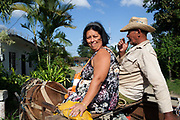 An older Cuban couple of the back of a horse, him with a cowboy hat on, Palmire, Cienfuegos province, Cuba. .