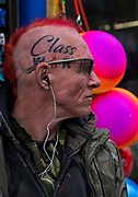 Punk with Class War tattooed on his head on 21st April 2021 in Blackpool, Lancashire, United Kingdom. Blackpool is a large town and seaside resort in the county of Lancashire on the north west coast of England. Blackpool was once a booming resort with it's famous promenade which now, despite having a somewhat shabby appearance, still continues to attract millions of visitors each year. During the coronavirus pandemic however, Blackpool has struggled, with empty streets and closed down businesses creating an atmosphere more like a ghost town.