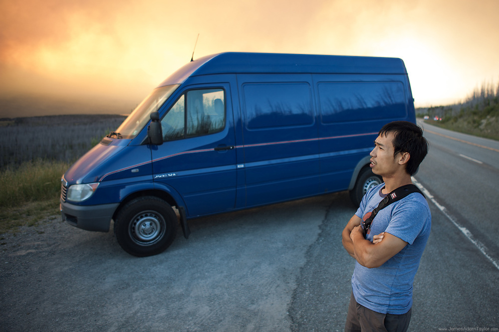 Ray Phung of Portland Oregon watches the Reynolds Creek Fire in Glacier National Park from a scenic turnout on  Highway 89. Tuesday, July 21.