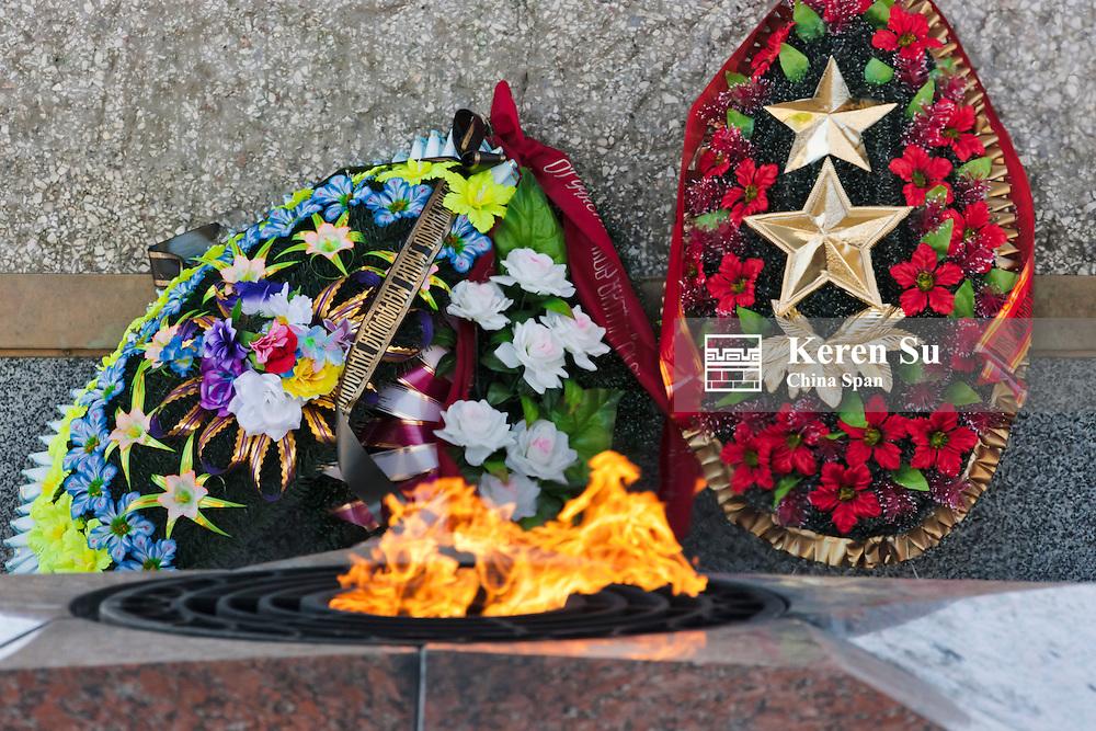 Flower wreaths and flame at WWII memorial in Victory Square, Vitebsk, Belarus