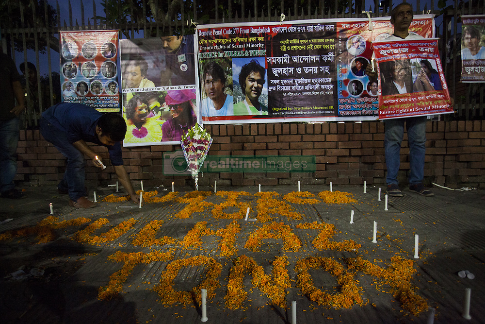 April 25, 2017 - Dhaka, Bangladesh - A candle-lit prayer was held in Dhaka, Bangladesh, on 25 April 2017 in remembrance, one year after the gruesome murders of LGBT activists Xulhaz Mannan and his friend Tonoy. The remembrance was organised by an LGBT activist at Shahbagh intersection. Xulhaz was a USAID official and also editor of Bangladesh's first LGBT magazine 'Roopbaan' and was a cousin of former foreign minister and ruling Awami League leader Dipu Moni. A gang of assailants, posing as delivery men, entered Xulhaz's apartment building in Dhaka's Kalabagan and killed him and his friend Tonoy with machetes on April 25 last year. (Credit Image: © Ahmed Salahuddin/NurPhoto via ZUMA Press)