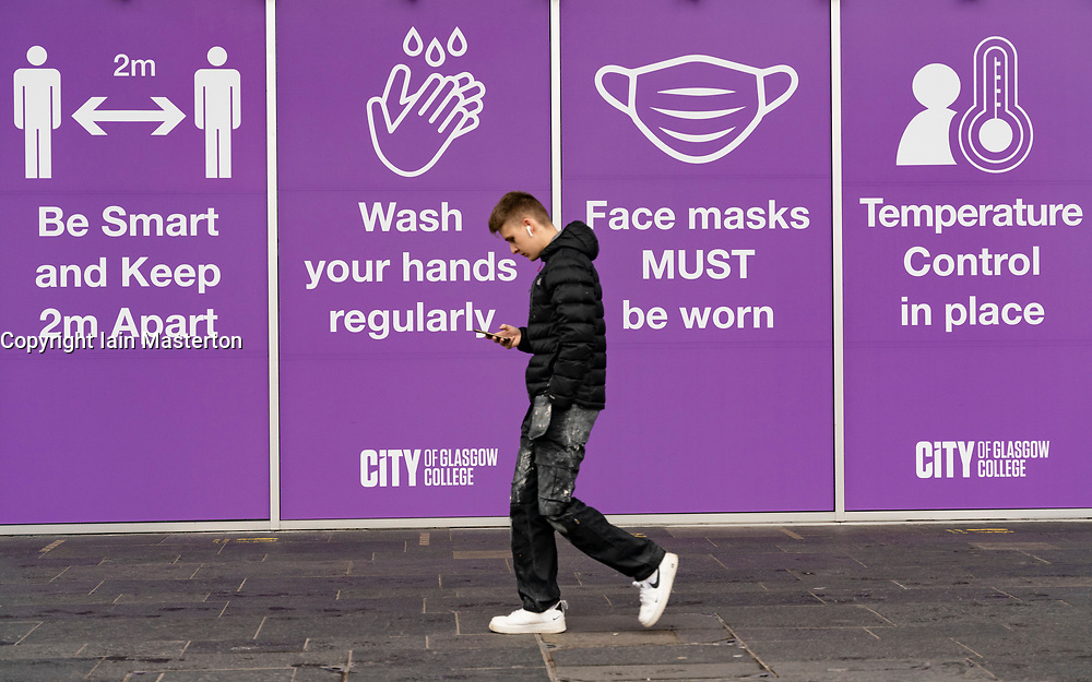Glasgow, Scotland, UK.1 December 2020. Coronavirus health warnings, shop display and graffiti in Glasgow city centre. Pictured; Sign outside Glasgow College.  Iain Masterton/Alamy Live News
