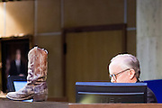 09 JANUARY 2012 - PHOENIX, AZ:  Sen President Steve Pierce put a boot on his desk at the state legislature Monday. Gov Brewer delivered her State of the State inside while outside representatives of interest groups picketed and protested.   The Arizona legislature started its 2012 session and Gov. Jan Brewer delivered her State of the State Monday, Jan 9.                   PHOTO BY JACK KURTZ