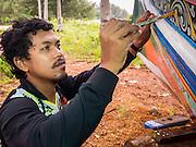 15 JUNE 2105 - NARATHIWAT, NARATHIWAT, THAILAND: A man paints a fishing boat in Narathiwat.       PHOTO BY JACK KURTZ