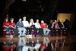 28 December 2009: Family, friends and faculty line up on the north end of the court at half time to watch a video about Kristi Cirone and hear her speak. Kristi Cirone - Illinois State University paid tribute to Kristi Cirone by raising a banner and retiring the Ladies Jersey #10, the number she wore for 4 years as a Redbird.  It was Kristi Cirone night, but The Blue Demons of DePaul University cling to the lead beating the Redbirds of Illinois State University by a score of 63-61 on Doug Collins Court in Redbird Arena in Normal Illinois.