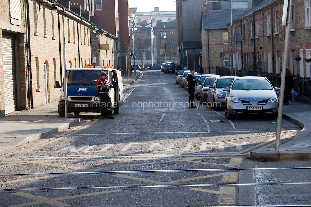 Dublin City Council workers clamping cars in Dublin city centre Ireland
