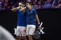 September 21, 2018 - Chicago, Illinois, U.S - Team Europe member ROGER FEDERER of Switzerland strategizes with partner NOVAK DJOKOVIC of Serbia during the first doubles match on Day One of the Laver Cup at the United Center in Chicago, Illinois. (Credit Image: © Shelley Lipton/ZUMA Wire)