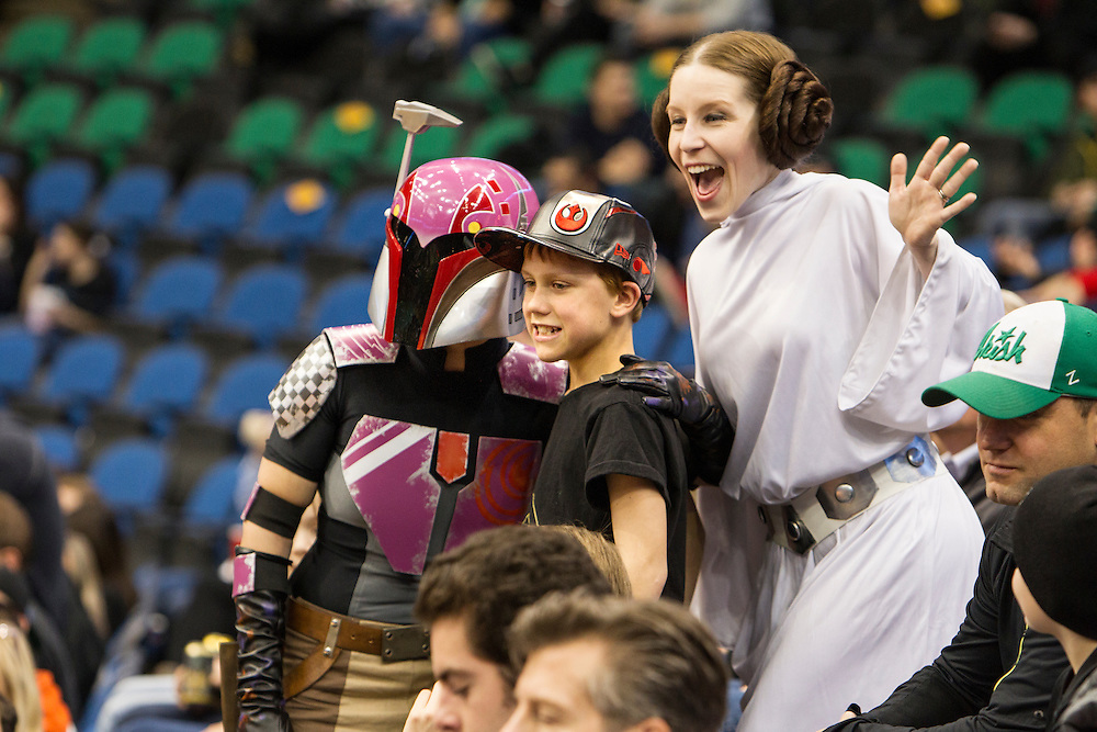 Sabine (Ashley Hay) and Princess Leia (Lynn Sessions) pose with Jaxson Moon, 11, of Richfield at Star Wars night at the Timberwolves game at Target Center in Minneapolis December 15, 2015.