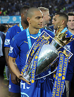 Football - 2015 / 2016 Premier League - Leicester City vs. Everton<br /> <br /> Danny Simpson of Leicester with the trophy at the King Power Stadium.<br /> <br /> COLORSPORT/ANDREW COWIE