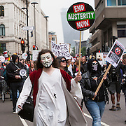 Men in masks at the People's Assembly Against Austerity 'End Austerity Now' demonstration attended by over 250,000 people on Saturday 20th of June 2015 sending a clear message to the Tory government; demanding an alternative to austerity and to policies that only benefit those at the top. London, UK.
