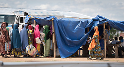 31 May 2019, Mokolo, Cameroon: People queue for food at a distribution point in the Minawao camp for Nigerian refugees. The Minawao camp for Nigerian refugees, located in the Far North region of Cameroon, hosts some 58,000 refugees from North East Nigeria.
