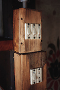 Electricity comes to the Bhutanese village of Shingkhey in 2001. There is an electricity usage meter mounted on the earthen wall of Nalim and Namgay's house in the village.