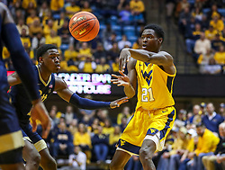 Dec 8, 2018; Morgantown, WV, USA; West Virginia Mountaineers forward Wesley Harris (21) passes the ball during the second half against the Pittsburgh Panthers at WVU Coliseum. Mandatory Credit: Ben Queen-USA TODAY Sports